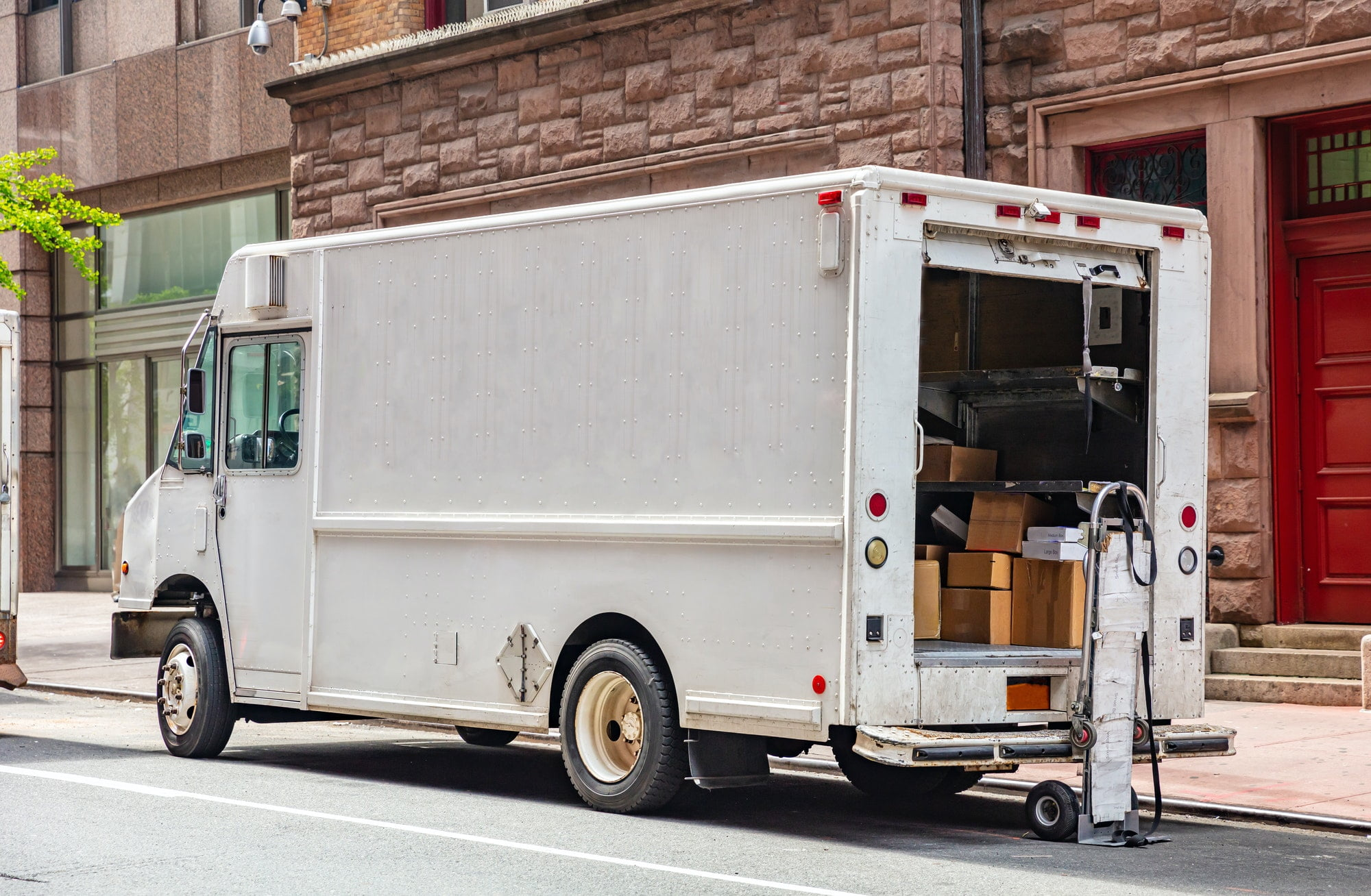 White color truck delivering packages, Manhattan downtown